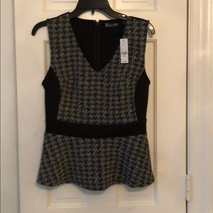 Peplum top. Very cute paired with matching skirt.